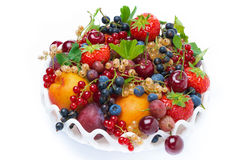 Dish with fruit and seasonal berries, top view, isolated Stock Image