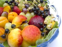 Dish of fruits. On white background stock images