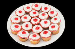 A dish full of cup cakes Stock Images