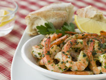 Dish of Garlic Buttered Tiger Prawns Stock Photo