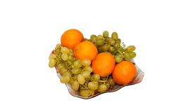Dish with grapes and tangerines Stock Photo