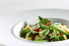 A dish of green bean. On a white plate Royalty Free Stock Photography