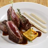 A dish of grilled beef steak with red wine sauce. Royalty Free Stock Photography