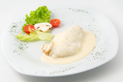 The dish of grilled chicken  with cream souse and garnished Stock Images