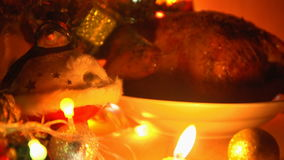 Dish with grilled chicken in the evening on Christmas eve. stock video footage