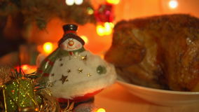 Dish with grilled chicken in the evening on Christmas eve. stock footage