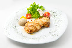 The dish of grilled chicken  and garnished Royalty Free Stock Photography