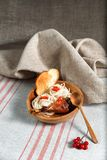 The dish is grilled chicken with spaghetti and spicy tomato sauce in a wooden bowl on a light tablecloth Stock Images