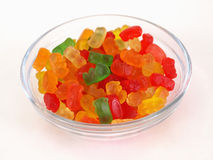 Dish of Gummy Bears. A small candy dish full of brightly colored candy bears. Over a white background Stock Photo