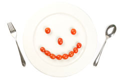 Dish happy. With tomato and spoon, silverware Stock Images