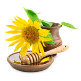 dish with honey drizzler and flowers sunflowers Royalty Free Stock Image