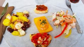 A dish of Italian appetizers royalty free stock images