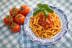 Penne with bacon and tomato sauce royalty free stock photos