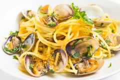 Spaghetti with clams and bottarga Royalty Free Stock Images