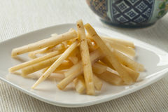 Dish with Japanese pickled burdock roots Stock Images
