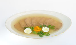 Dish with jellied beef tongue on white. Royalty Free Stock Images