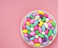 Dish of Jordan Almonds against Bright Pink Stock Photo
