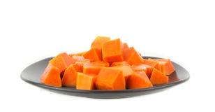 Dish of juicy papaya -tropical fruit on white Royalty Free Stock Image