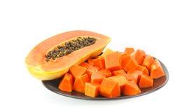Dish of juicy papaya -tropical fruit on white Stock Photo