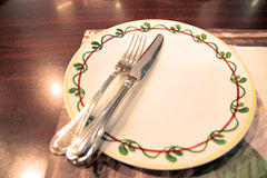 Dish and knife in restaurant. Royalty Free Stock Photos