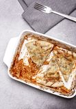 Dish of leftover pasta bake and cheesy garlic bread Royalty Free Stock Image