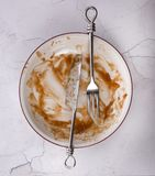 Dish of leftovers with knife and fork Royalty Free Stock Photo