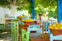 A dish of lemons in typical greek outdoor cafe Stock Images