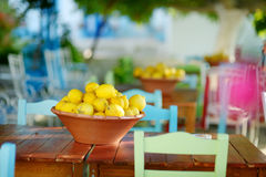 A dish of lemons in typical greek outdoor cafe Stock Photography