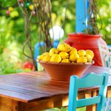 A dish of lemons in typical greek outdoor cafe Royalty Free Stock Photography
