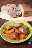 Dish with meat and carrots the cut bread on a table Royalty Free Stock Image