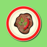 Fried or stewed meat with pepper and parsley on the plate Royalty Free Stock Image