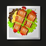 Dish of meat on skewers, tomatoes and herbs on black background. Dish of meat on skewers, tomatoes and herbs