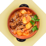 Dish of meat soup with potatoes in ceramic pot. Royalty Free Stock Photography