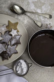 The dish of melted chocolate with Christmas cookies Stock Images