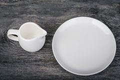 Dish and milk jug Stock Photos