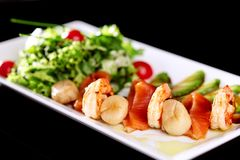 Dish mix of salads with seafood royalty free stock photos
