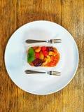 A dish of mixed fruits cake isolated on white dish background stock photos