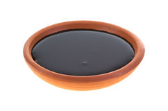 Dish of molasses. A small dish with molasses on a white background Stock Photos