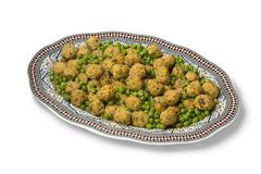 Dish with Moroccan style minced chicken balls and green peas stock photos