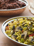 Dish of Mushroom Pilau Rice with Beef Madras Royalty Free Stock Photo