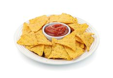 Dish of nacho chips and tomato dip sauce Stock Images