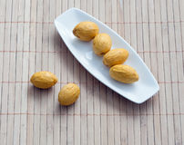 Dish of nuts on a bamboo napkin Royalty Free Stock Images