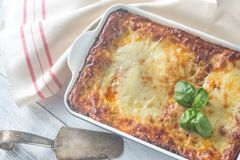 Dish Of Lasagne On The Wooden Table Stock Photography