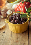 Dish of Olives on Table with Fresh Vegetables Stock Photography