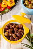 Dish of Olives on Wooden Table with Antipasti Royalty Free Stock Photo