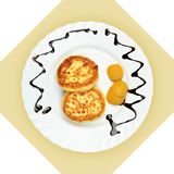 Dish of pancakes with dried apricot Stock Photo