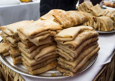Dish of pancakes stuffed with lies on the street counter on holiday of Maslenitsa.  royalty free stock photography