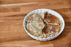 Dish with pancakes on a taule Stock Image