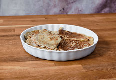 Dish with pancakes on a taule Stock Images