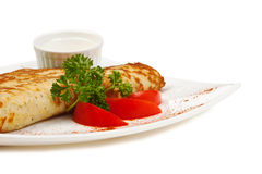 Dish of pancakes with vegetables Stock Images